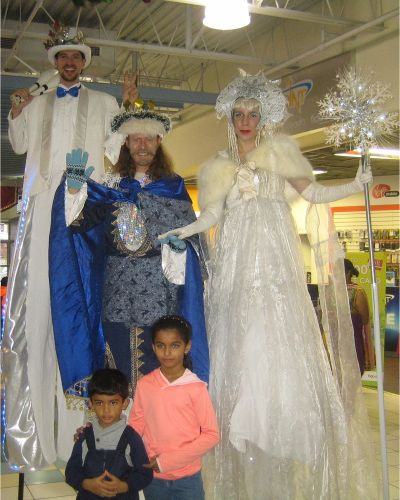 stilters in costume for holiday winter wonderland events