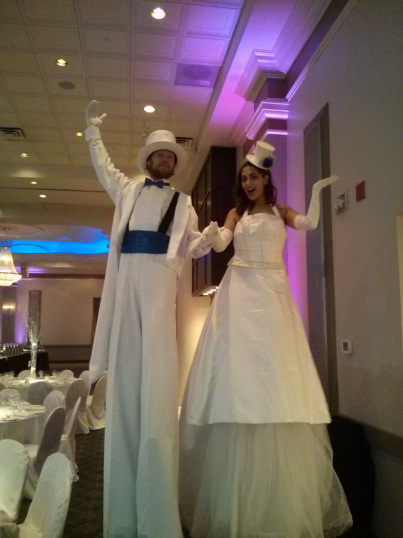 stilt walkers white formal attire